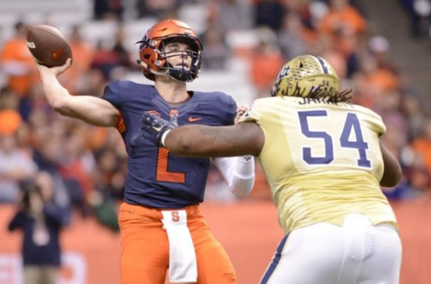 Oct 24, 2015; Syracuse, NY, USA; Syracuse Orange quarterback Eric Dungey (2) throws a pass under pressure by Pittsburgh Panthers defensive lineman Tyrique Jarrett (54) during the first quarter of a game at the Carrier Dome. Mandatory Credit: Mark Konezny-USA TODAY Sports