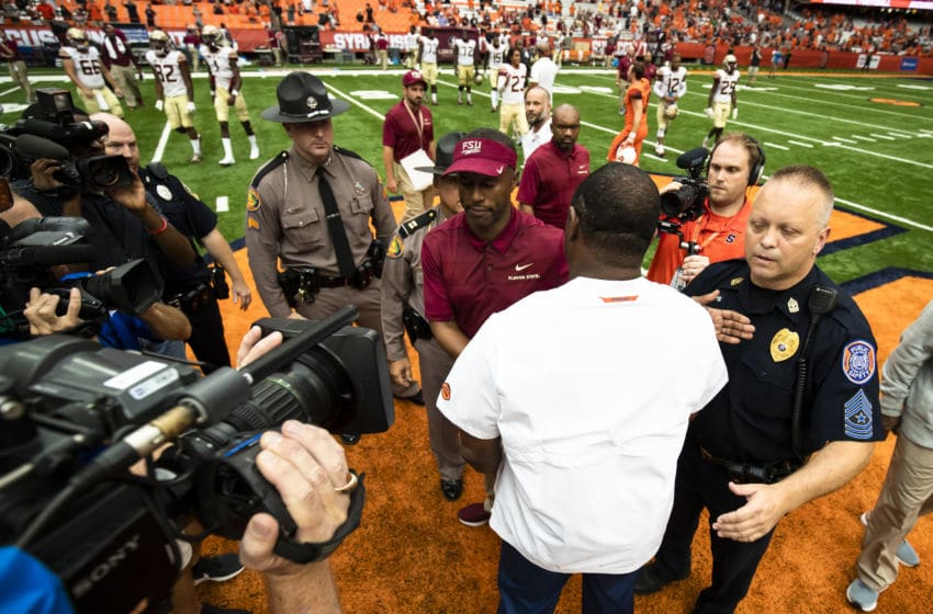 SYRACUSE, NY - SEPTEMBER 15: Head coach Dino Babers of the Syracuse Orange and head coach Willie Taggart of the Florida State Seminoles shake hands after the game at the Carrier Dome on September 15, 2018 in Syracuse, New York. Syracuse defeats Florida State 30-7. (Photo by Brett Carlsen/Getty Images)