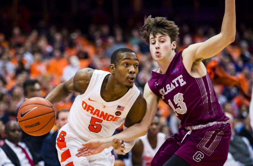 SYRACUSE, NY - NOVEMBER 21: Jalen Carey #5 of the Syracuse Orange drives to the basket against Jack Ferguson #13 of the Colgate Raiders during the second half at the Carrier Dome on November 21, 2018 in Syracuse, New York. (Photo by Brett Carlsen/Getty Images)