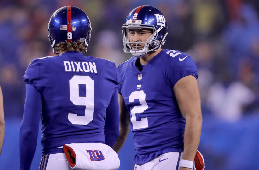 EAST RUTHERFORD, NEW JERSEY - DECEMBER 02: Aldrick Rosas #2 of the New York Giants is congratulated by teammate Riley Dixon #9 after Rosas kicked the game winning field goal in overtime against the Chicago Bears at MetLife Stadium on December 02, 2018 in East Rutherford, New Jersey. (Photo by Elsa/Getty Images)