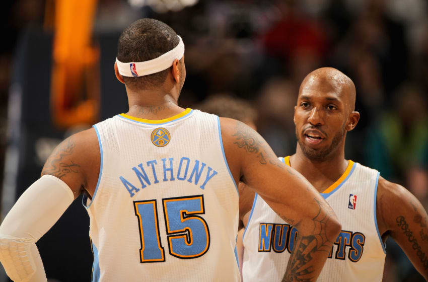 DENVER, CO - JANUARY 21: Carmelo Anthony #15 and Chauncey Billups #1 of the Denver Nuggets talk during a break in the action against the Los Angeles Lakers at the Pepsi Center on January 21, 2011 in Denver, Colorado. The Lakers defeated the Nuggets 107-97. NOTE TO USER: User expressly acknowledges and agrees that, by downloading and or using this photograph, User is consenting to the terms and conditions of the Getty Images License Agreement. (Photo by Doug Pensinger/Getty Images)