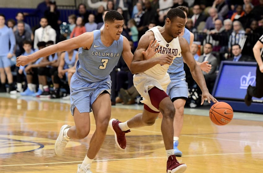NEW YORK, NEW YORK - MARCH 09: Chris Lewis #0 of the Harvard Crimson is defended by Patrick Tape #3 of the Columbia Lions at Frances S. Levien Gymnasium on March 09, 2019 in New York City. (Photo by Steven Ryan/Getty Images)