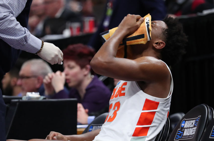 SALT LAKE CITY, UTAH - MARCH 21: Elijah Hughes #33 of the Syracuse Orange sits on the bench after getting hit in the face by Freddie Gillespie (not pictured) #33 of the Baylor Bears during the second half in the first round of the 2019 NCAA Men's Basketball Tournament at Vivint Smart Home Arena on March 21, 2019 in Salt Lake City, Utah. (Photo by Tom Pennington/Getty Images)