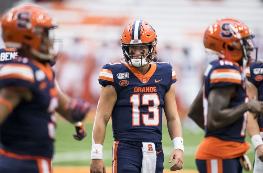 SYRACUSE, NY - SEPTEMBER 28: Tommy DeVito #13 of the Syracuse Orange warms up before the game against the Holy Cross Crusaders at the Carrier Dome on September 28, 2019 in Syracuse, New York. (Photo by Brett Carlsen/Getty Images)