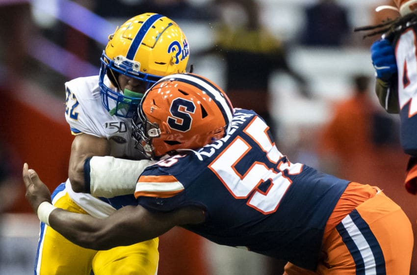 SYRACUSE, NY - OCTOBER 18: Vincent Davis #22 of the Pittsburgh Panthers is brought down by Kendall Coleman #55 of the Syracuse Orange during the fourth quarter at the Carrier Dome on October 18, 2019 in Syracuse, New York. Pittsburgh defeats Syracuse 27-20. (Photo by Brett Carlsen/Getty Images)