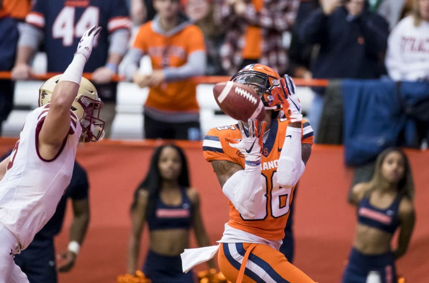 SYRACUSE, NY - NOVEMBER 02: Trishton Jackson #86 of the Syracuse Orange makes a touchdown reception as Nolan Borgersen #5 of the Boston College Eagles defends during the first quarter at the Carrier Dome on November 2, 2019 in Syracuse, New York. (Photo by Brett Carlsen/Getty Images)