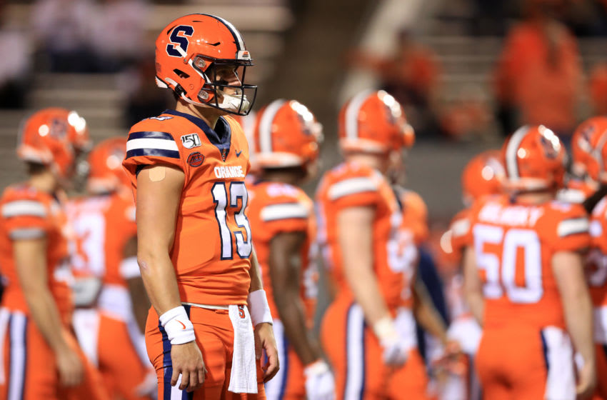 RALEIGH, NORTH CAROLINA - OCTOBER 10: Tommy DeVito #13 of the Syracuse Orange warms up before their game against the North Carolina State Wolfpack at Carter Finley Stadium on October 10, 2019 in Raleigh, North Carolina. (Photo by Streeter Lecka/Getty Images)