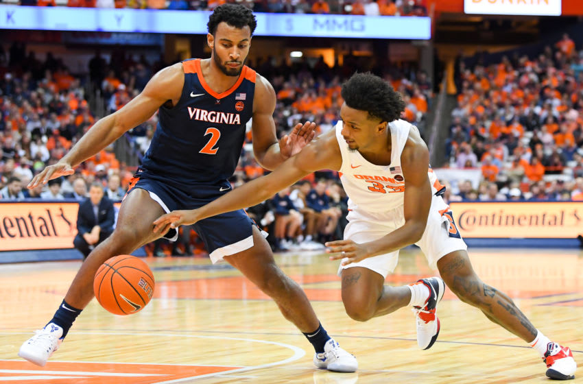 SYRACUSE, NY - NOVEMBER 06: Braxton Key #2 of the Virginia Cavaliers and Elijah Hughes #33 of the Syracuse Orange battle for a loose ball during the second half at the Carrier Dome on November 6, 2019 in Syracuse, New York. Virginia defeated Syracuse 48-34. (Photo by Rich Barnes/Getty Images)
