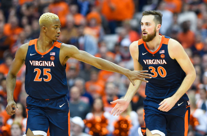 SYRACUSE, NY - NOVEMBER 06: Mamadi Diakite #25 of the Virginia Cavaliers greets teammate Jay Huff #30 following a made basket against the Syracuse Orange during the second half at the Carrier Dome on November 6, 2019 in Syracuse, New York. Virginia defeated Syracuse 48-34. (Photo by Rich Barnes/Getty Images)