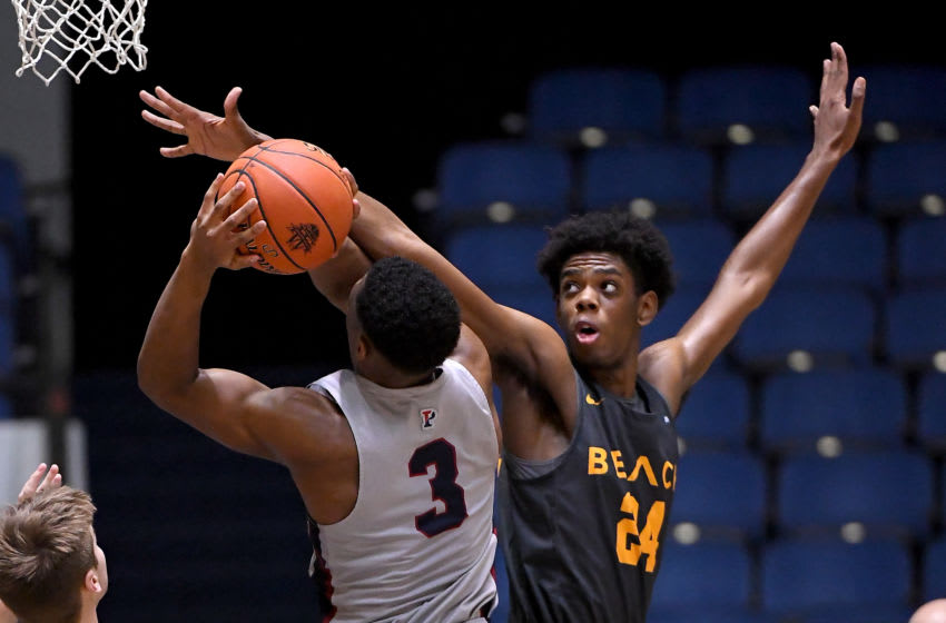 ANAHEIM, CA - DECEMBER 01: Joshua Morgan #24 of the Long Beach State 49ers defends a shot by Jordan Dingle #3 of the Pennsylvania Quakers in the second half of the game of the third place game of the Wooden Legacy at the Anaheim Convention Center at on December 1, 2019 in Anaheim, California. (Photo by Jayne Kamin-Oncea/Getty Images)