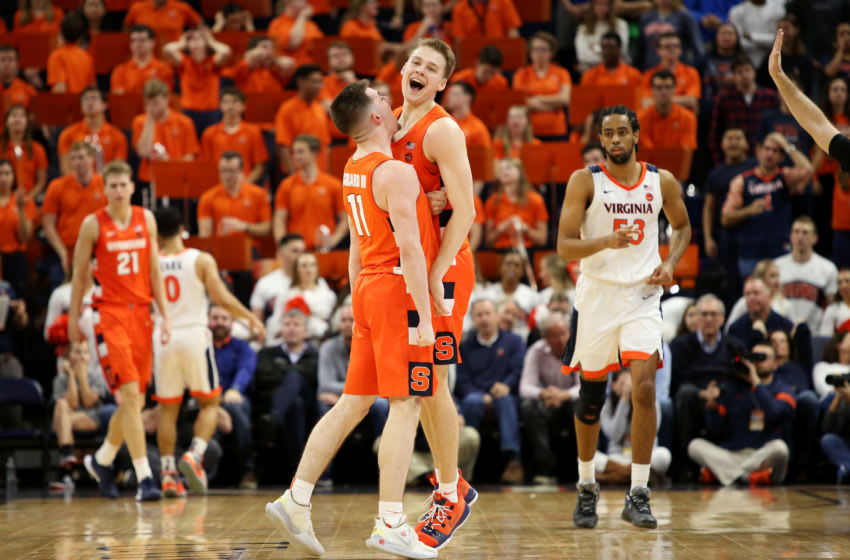 CHARLOTTESVILLE, VA - JANUARY 11: Joseph Girard III #11 and Buddy Boeheim #35 of the Syracuse Orange celebrate a shot in overtime during a game against the Virginia Cavaliers at John Paul Jones Arena on January 11, 2020 in Charlottesville, Virginia. (Photo by Ryan M. Kelly/Getty Images)