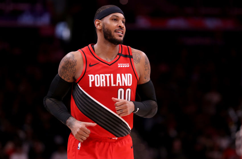 WASHINGTON, DC - JANUARY 03: Carmelo Anthony #00 of the Portland Trail Blazers looks on against the Washington Wizards in the first half at Capital One Arena on January 03, 2020 in Washington, DC. NOTE TO USER: User expressly acknowledges and agrees that, by downloading and/or using this photograph, user is consenting to the terms and conditions of the Getty Images License Agreement. (Photo by Rob Carr/Getty Images)