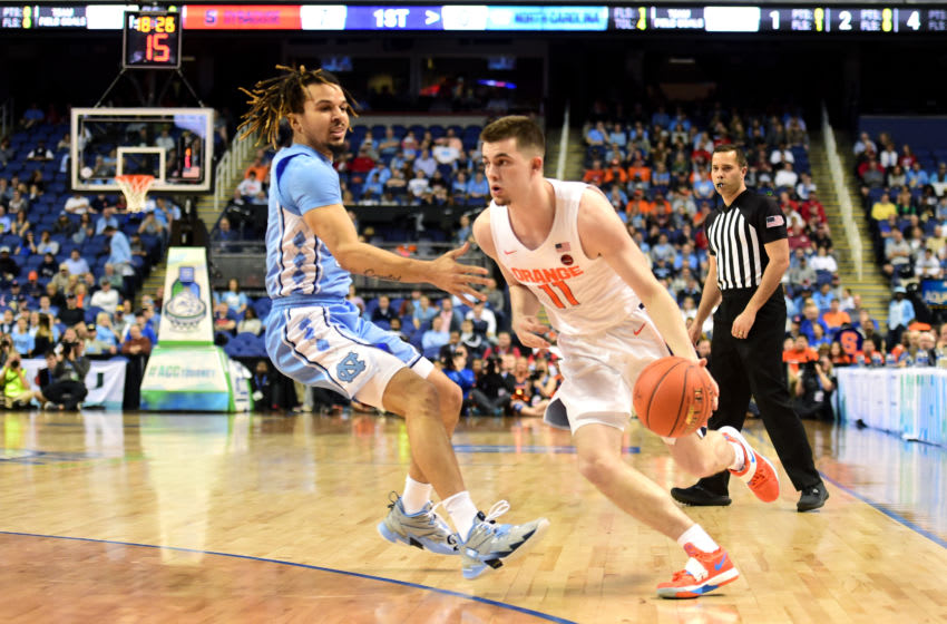 GREENSBORO, NORTH CAROLINA - MARCH 11: Joseph Girard III #11 of the Syracuse Orange dribbles against Cole Anthony #2 of the North Carolina Tar Heels during their game in the second round of the 2020 Men's ACC Basketball Tournament at Greensboro Coliseum on March 11, 2020 in Greensboro, North Carolina. (Photo by Jared C. Tilton/Getty Images)