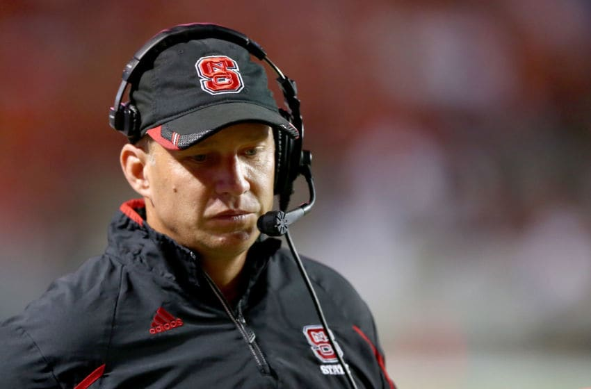 RALEIGH, NC - SEPTEMBER 19: Head coach Dave Doeren of the North Carolina State Wolfpack looks on from the sidelines during their game against the Clemson Tigers at Carter-Finley Stadium on September 19, 2013 in Raleigh, North Carolina. (Photo by Streeter Lecka/Getty Images)