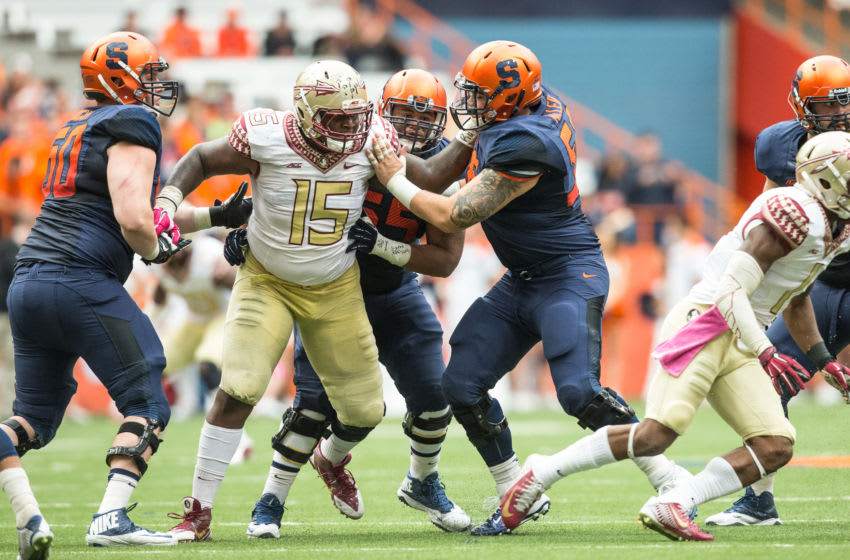 SYRACUSE, NY - OCTOBER 11: Mario Edwards Jr. #15 of the Florida State Seminoles pushes through Syracuse Orange offensive line on October 11, 2014 at The Carrier Dome in Syracuse, New York. Florida State Seminoles defeat Syracuse Orange 38-20. (Photo by Brett Carlsen/Getty Images)