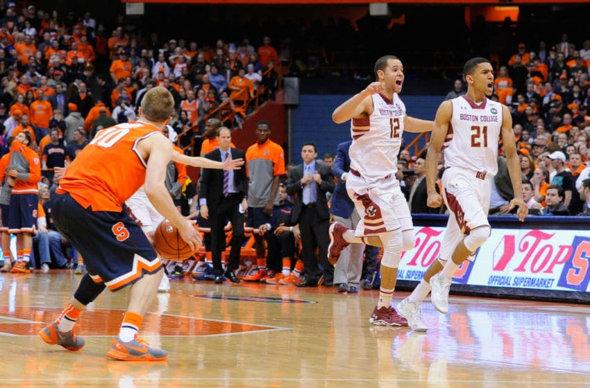 SYRACUSE, NY - FEBRUARY 19: Ryan Anderson #12 and Olivier Hanlan #21 of the Boston College Eagles celebrate following the game against the Syracuse Orange at the Carrier Dome on February 19, 2014 in Syracuse, New York. Boston College defeated Syracuse 62-59 in overtime. (Photo by Rich Barnes/Getty Images)