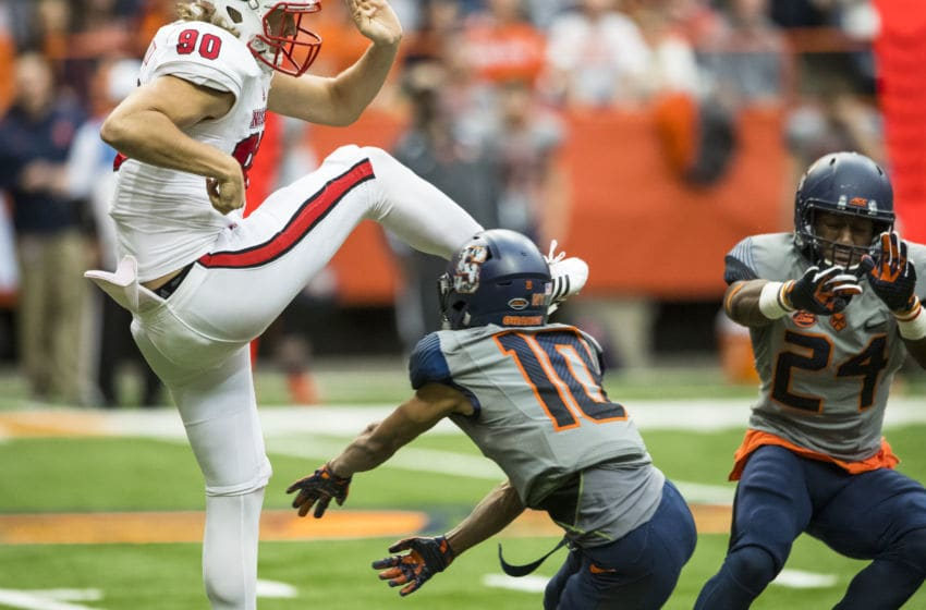 SYRACUSE, NY - NOVEMBER 12: Sean Riley #10 and Shyheim Cullen #24 block a punt by A.J. Cole III #90 of the North Carolina State Wolfpack during the third quarter on November 12, 2016 at The Carrier Dome in Syracuse, New York. (Photo by Brett Carlsen/Getty Images)