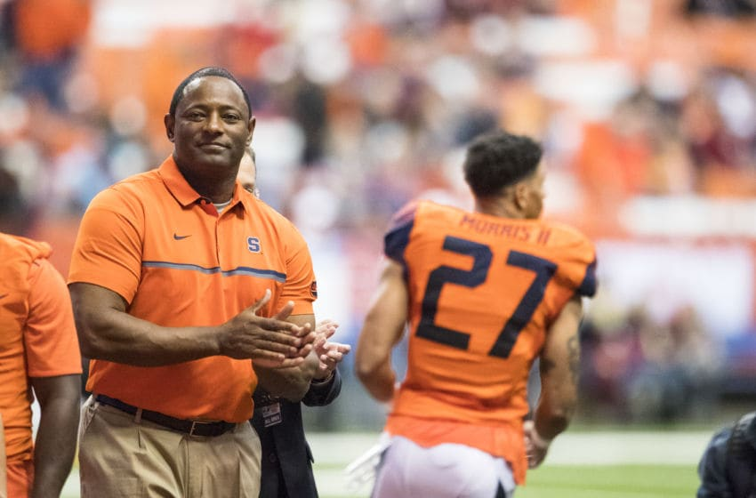 SYRACUSE, NY - NOVEMBER 19: Head coach Dino Babers of the Syracuse Orange congratulates senior players before the game against the Florida State Seminoles on November 19, 2016 at The Carrier Dome in Syracuse, New York. (Photo by Brett Carlsen/Getty Images)