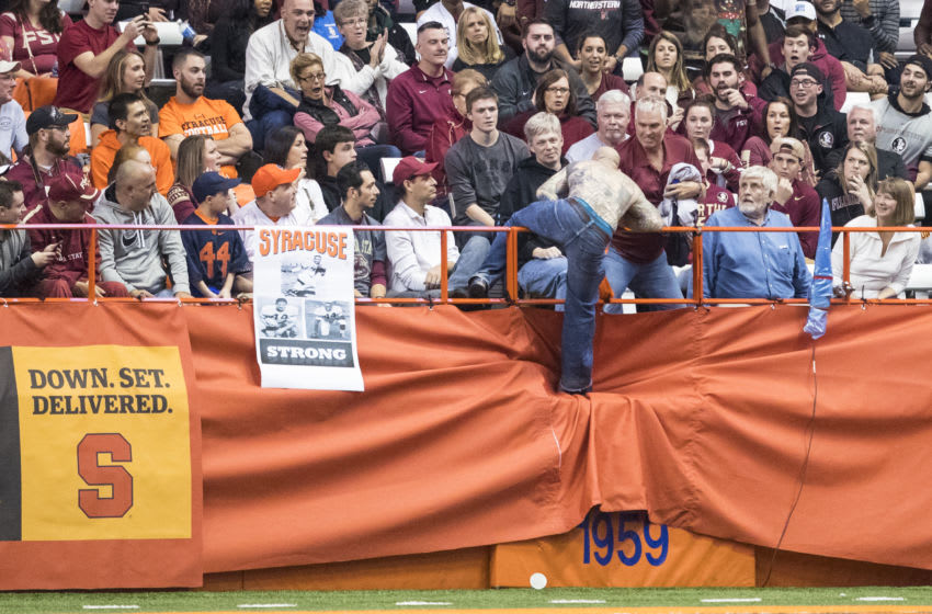 SYRACUSE, NY - NOVEMBER 19: A fan wearing no shirt runs across the field during the game between the Syracuse Orange and the Florida State Seminoles on November 19, 2016 at The Carrier Dome in Syracuse, New York. Florida State defeats Syracuse 45-14. (Photo by Brett Carlsen/Getty Images)