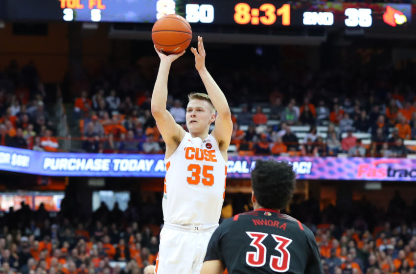 SYRACUSE, NY - FEBRUARY 20: Buddy Boeheim #35 of the Syracuse Orange shoots the ball over Jordan Nwora #33 of the Louisville Cardinals during the second half at the Carrier Dome on February 20, 2019 in Syracuse, New York. Syracuse defeated Louisville 69-49. (Photo by Rich Barnes/Getty Images)