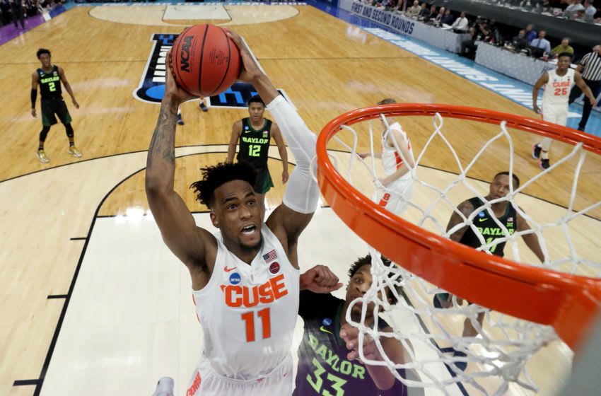 SALT LAKE CITY, UTAH - MARCH 21: Oshae Brissett #11 of the Syracuse Orange dunks the ball against Freddie Gillespie #33 of the Baylor Bears during the first half in the first round of the 2019 NCAA Men's Basketball Tournament at Vivint Smart Home Arena on March 21, 2019 in Salt Lake City, Utah. (Photo by Tom Pennington/Getty Images)