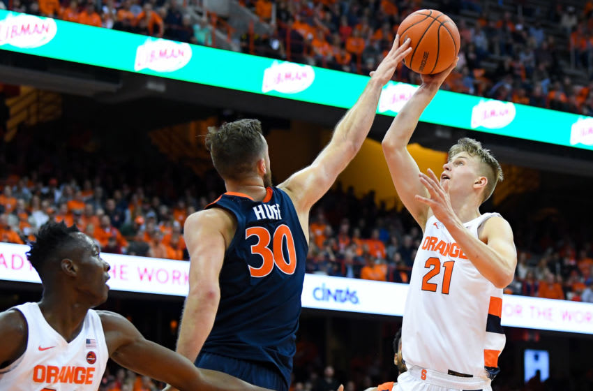 SYRACUSE, NY - NOVEMBER 06: Jay Huff #30 of the Virginia Cavaliers alters the shot of Marek Dolezaj #21 of the Syracuse Orange during the second half at the Carrier Dome on November 6, 2019 in Syracuse, New York. Virginia defeated Syracuse 48-34. (Photo by Rich Barnes/Getty Images)