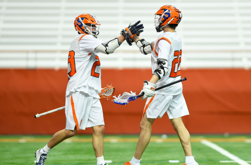 SYRACUSE, NY - FEBRUARY 07: Stephen Rehfuss (L) and Chase Scanlan (R) of the Syracuse Orange celebrate a goal against the Colgate Raiders during the first half at the Carrier Dome on February 7, 2020 in Syracuse, New York. (Photo by Rich Barnes/Getty Images)