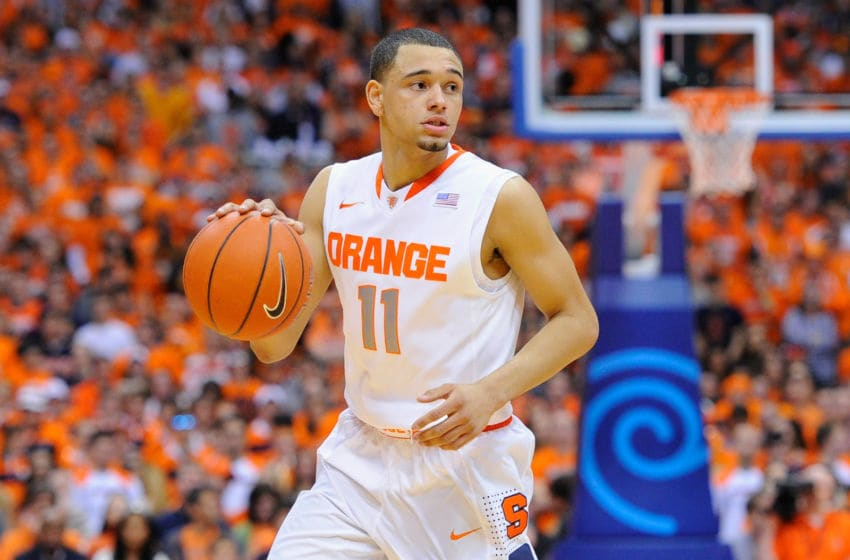 SYRACUSE, NY - FEBRUARY 15: Tyler Ennis #11 of the Syracuse Orange controls the ball against the North Carolina State Wolfpack during the first half at the Carrier Dome on February 15, 2014 in Syracuse, New York. Syracuse defeated North Carolina State 56-55. (Photo by Rich Barnes/Getty Images)