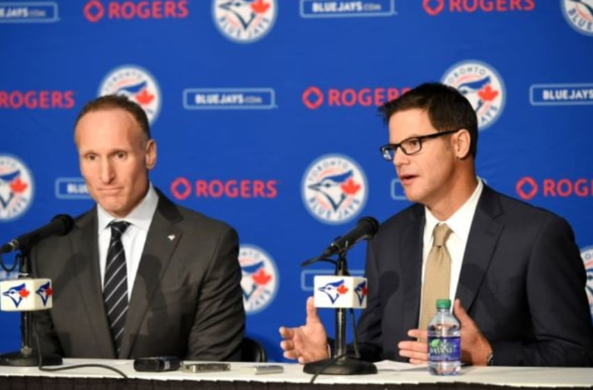 Dec 4, 2015; Toronto, Ontario, Canada; Toronto Blue Jays new general manager Ross Atkins (right) answers questions along with club president Mark Shapiro during an introductory media conference at Rogers Centre. Mandatory Credit: Dan Hamilton-USA TODAY Sports