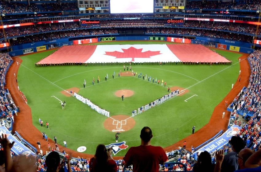 Jul 1, 2015; Toronto, Ontario, CAN; A giant Canadian flag is unfurled at center field by Canadian Armed Forces personnel during pre-game festivities to honor Canada Day before the Boston Red Sox played Toronto Blue Jays at Rogers Centre. Mandatory Credit: Dan Hamilton-USA TODAY Sports