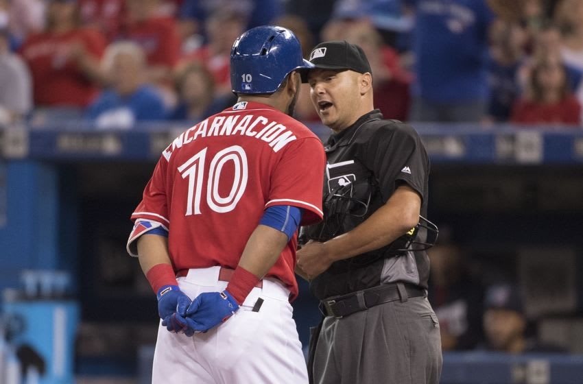 Jul 1, 2016; Toronto, Ontario, CAN; Toronto Blue Jays designated hitter Edwin Encarnacion (10) argues a strike out call with home late umpire Vic Carapazza during the first inning in a game against the Cleveland Indians Rogers Centre. Mandatory Credit: Nick Turchiaro-USA TODAY Sports