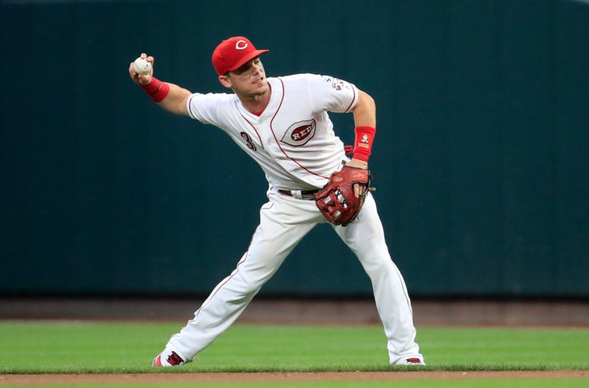 CINCINNATI, OH - JULY 26: Scooter Gennett #3 of the Cincinnati Reds throws the ball to first base against the Philadelphia Phillies at Great American Ball Park on July 26, 2018 in Cincinnati, Ohio. (Photo by Andy Lyons/Getty Images)