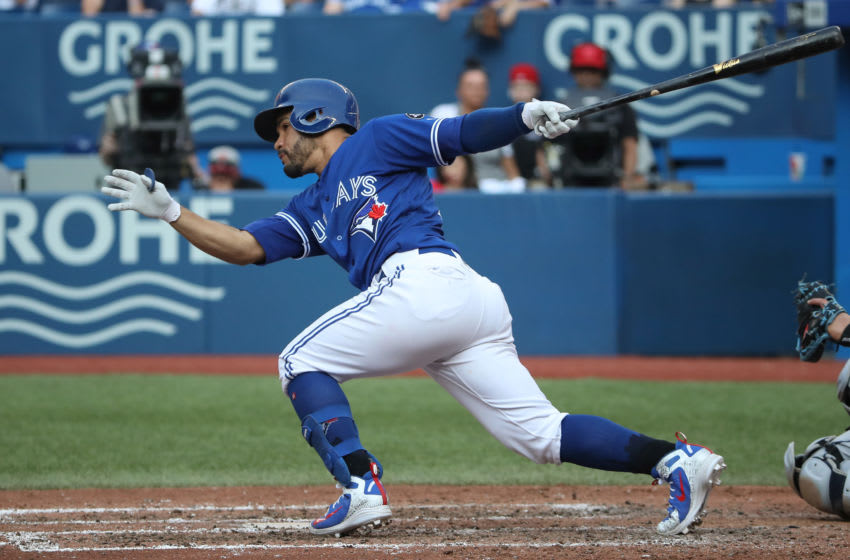 TORONTO, ON - AUGUST 11: Devon Travis #29 of the Toronto Blue Jays hits a single in the fifth inning during MLB game action against the Tampa Bay Rays at Rogers Centre on August 11, 2018 in Toronto, Canada. (Photo by Tom Szczerbowski/Getty Images)