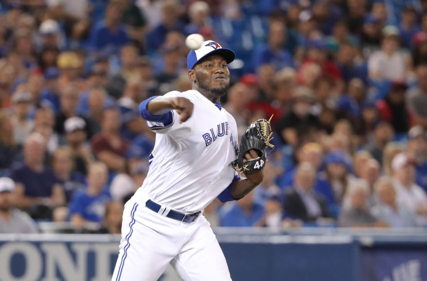 TORONTO, ON - SEPTEMBER 6: David Paulino #22 of the Toronto Blue Jays makes a throwing error to first base as he fields a soft grounder in the eighth inning during MLB game action against the Cleveland Indians at Rogers Centre on September 6, 2018 in Toronto, Canada. (Photo by Tom Szczerbowski/Getty Images)