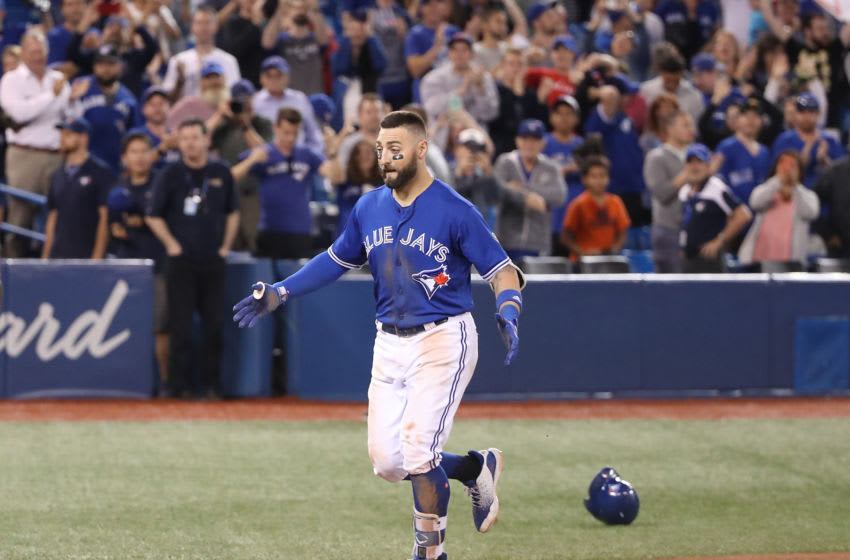 TORONTO, ON - SEPTEMBER 7: Kevin Pillar #11 of the Toronto Blue Jays jogs home after hitting a game-winning solo home run in the eleventh inning during MLB game action against the Cleveland Indians at Rogers Centre on September 7, 2018 in Toronto, Canada. (Photo by Tom Szczerbowski/Getty Images)