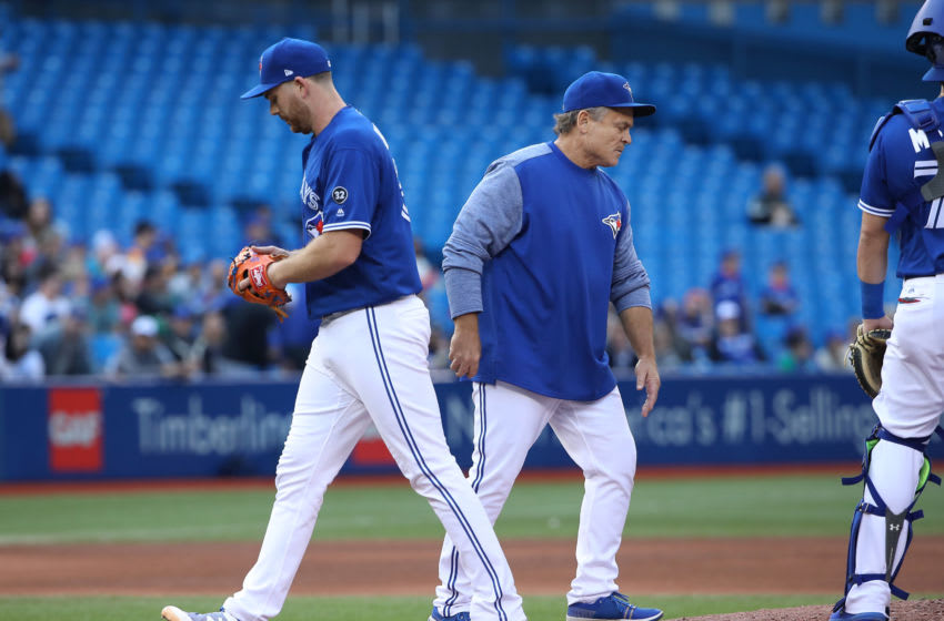 TORONTO, ON - SEPTEMBER 26: Joe Biagini #31 of the Toronto Blue Jays exits the game as he is relieved by manager John Gibbons #5 in the fifth inning during MLB game action against the Houston Astros at Rogers Centre on September 26, 2018 in Toronto, Canada. (Photo by Tom Szczerbowski/Getty Images)