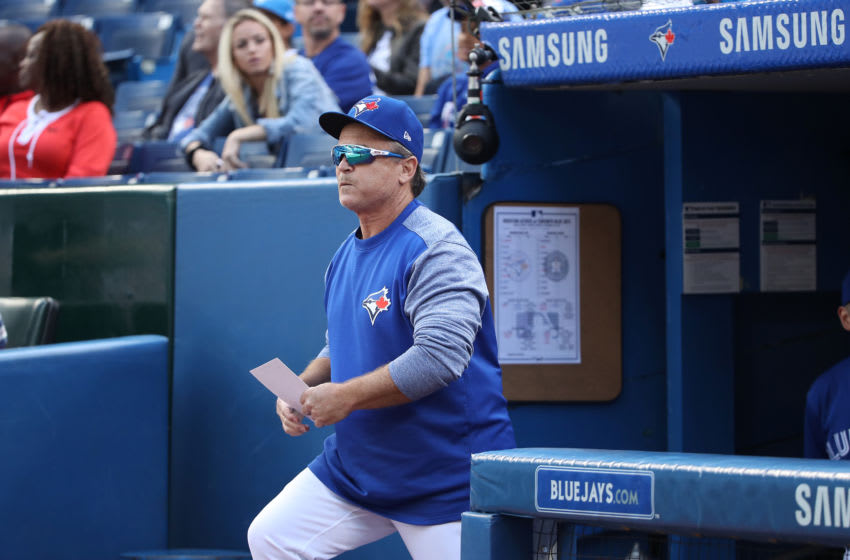 TORONTO, ON - SEPTEMBER 26: Manager John Gibbons #5 of the Toronto Blue Jays walks out of the dugout to deliver the lineup card to the umpires on his final home game as manager prior to the start of MLB game action against the Houston Astros at Rogers Centre on September 26, 2018 in Toronto, Canada. (Photo by Tom Szczerbowski/Getty Images)