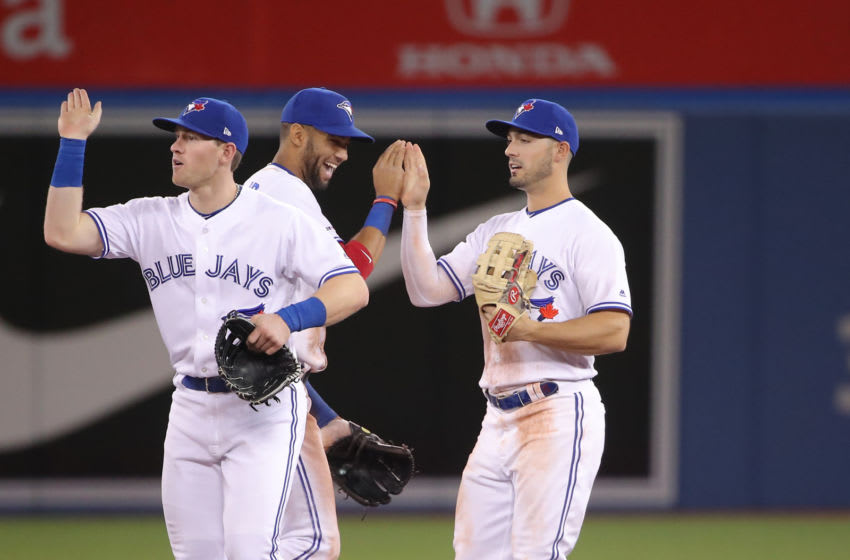 TORONTO, ON - APRIL 03: Randal Grichuk #15 of the Toronto Blue Jays celebrates their victory with Lourdes Gurriel Jr. #13 during MLB game action against the Baltimore Orioles at Rogers Centre on April 3, 2019 in Toronto, Canada. (Photo by Tom Szczerbowski/Getty Images)