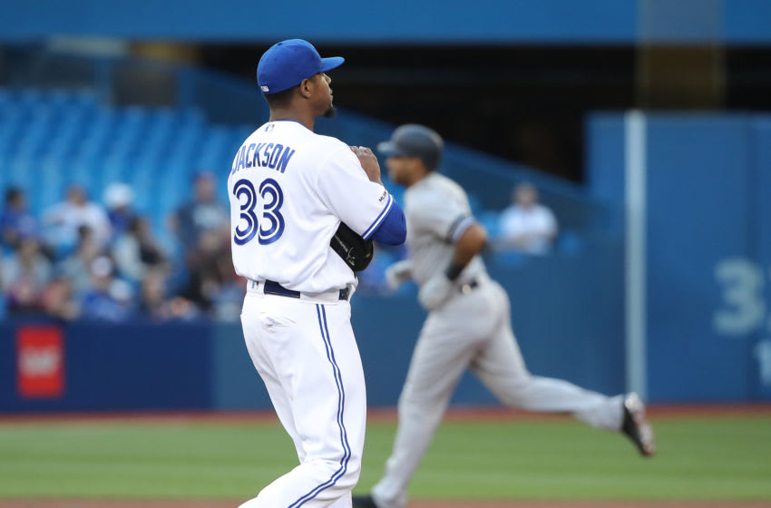 TORONTO, ON - JUNE 06: Edwin Jackson #33 of the Toronto Blue Jays reacts after giving up a three-run home run to Aaron Hicks #31 of the New York Yankees in the second inning during MLB game action at Rogers Centre on June 6, 2019 in Toronto, Canada. (Photo by Tom Szczerbowski/Getty Images)