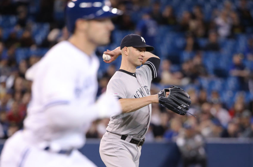TORONTO, ON - JUNE 06: J.A. Happ #34 of the New York Yankees fields a grounder and throws out Randal Grichuk #15 of the Toronto Blue Jays in the sixth inning during MLB game action at Rogers Centre on June 6, 2019 in Toronto, Canada. (Photo by Tom Szczerbowski/Getty Images)