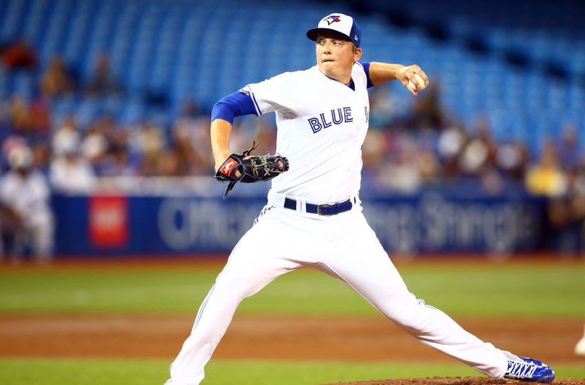 TORONTO, ON - JULY 22: Ryan Borucki #56 of the Toronto Blue Jays delivers a pitch in the second inning during a MLB game against the Cleveland Indians at Rogers Centre on July 22, 2019 in Toronto, Canada. (Photo by Vaughn Ridley/Getty Images)