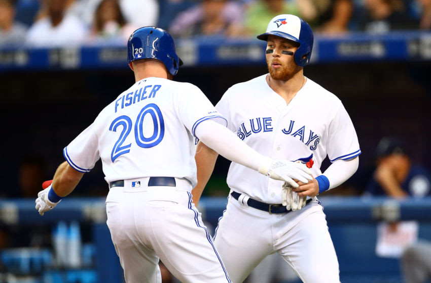 TORONTO, ON - AUGUST 16: Derek Fisher #20 of the Toronto Blue Jays celebrates a 2 run home run with Brandon Drury (R) #3 in the second inning during a MLB game against the Seattle Mariners at Rogers Centre on August 16, 2019 in Toronto, Canada. (Photo by Vaughn Ridley/Getty Images)
