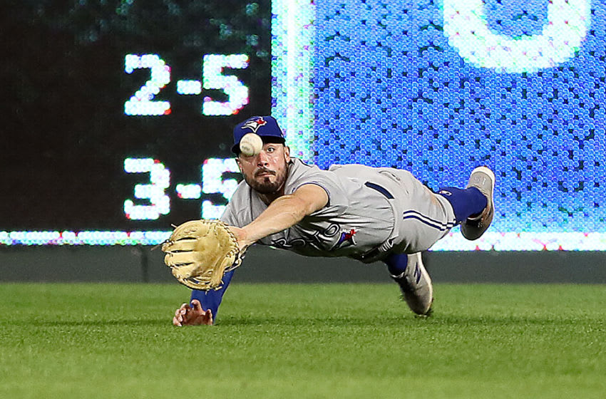 KANSAS CITY, MISSOURI - JULY 30: Randal Grichuk #15 of the Toronto Blue Jays makes a diving catch during the 8th inning of the game against the Kansas City Royals at Kauffman Stadium on July 30, 2019 in Kansas City, Missouri. (Photo by Jamie Squire/Getty Images)