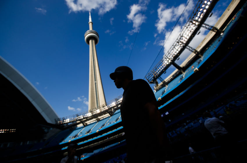 TORONTO, ONTARIO - AUGUST 8: Aaron Judge #99 of the New York Yankees is silhouetted on front of the CN Tower during batting practice before playing the Toronto Blue Jays in their MLB game at the Rogers Centre on August 8, 2019 in Toronto, Canada. (Photo by Mark Blinch/Getty Images)