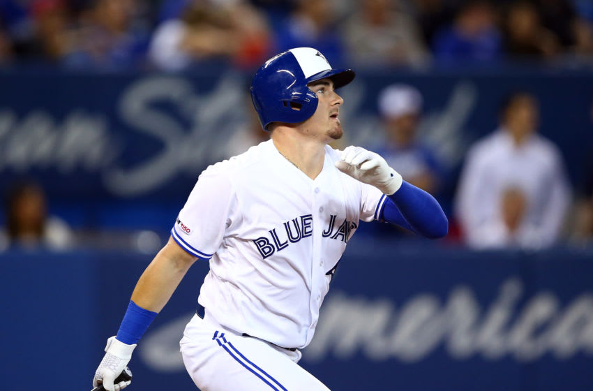 TORONTO, ON - SEPTEMBER 10: Reese McGuire #10 of the Toronto Blue Jays hits a home run in the fourth inning during a MLB game against the Boston Red Sox at Rogers Centre on September 10, 2019 in Toronto, Canada. (Photo by Vaughn Ridley/Getty Images)