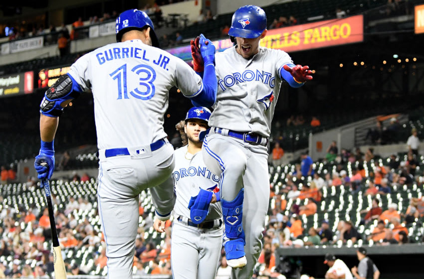 BALTIMORE, MD - SEPTEMBER 17: Cavan Biggio #8 of the Toronto Blue Jays celebrates with Lourdes Gurriel Jr. #13 after hitting a two-run home run in the third inning against the Baltimore Orioles at Oriole Park at Camden Yards on September 17, 2019 in Baltimore, Maryland. (Photo by Greg Fiume/Getty Images)