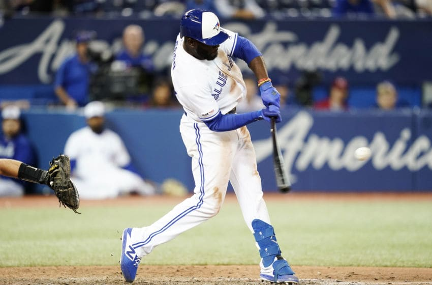 TORONTO, ONTARIO - SEPTEMBER 23: Anthony Alford #30 of the Toronto Blue Jays hits a walk off home run against the Baltimore Orioles in the 15th inning during their MLB game at the Rogers Centre on September 23, 2019 in Toronto, Canada. (Photo by Mark Blinch/Getty Images)