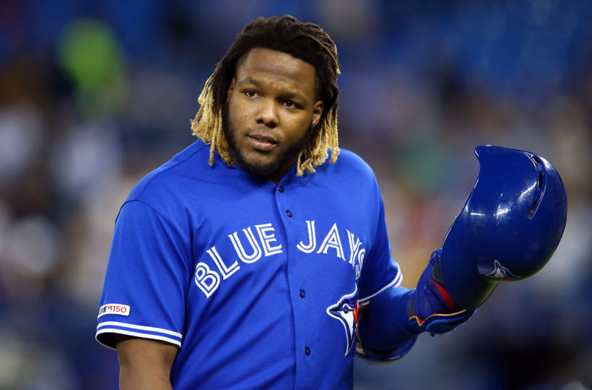 TORONTO, ON - SEPTEMBER 25: Vladimir Guerrero Jr. #27 of the Toronto Blue Jays reacts after grounding out in the first inning during a MLB game against the Baltimore Orioles at Rogers Centre on September 25, 2019 in Toronto, Canada. (Photo by Vaughn Ridley/Getty Images)