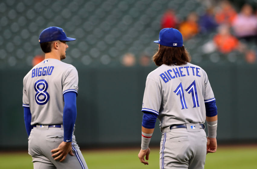 BALTIMORE, MARYLAND - SEPTEMBER 19: Cavan Biggio #8 and Bo Bichette #11 of the Toronto Blue Jays warm up before the start of the Blue Jays and Baltimore Orioles game at Oriole Park at Camden Yards on September 19, 2019 in Baltimore, Maryland. (Photo by Rob Carr/Getty Images)