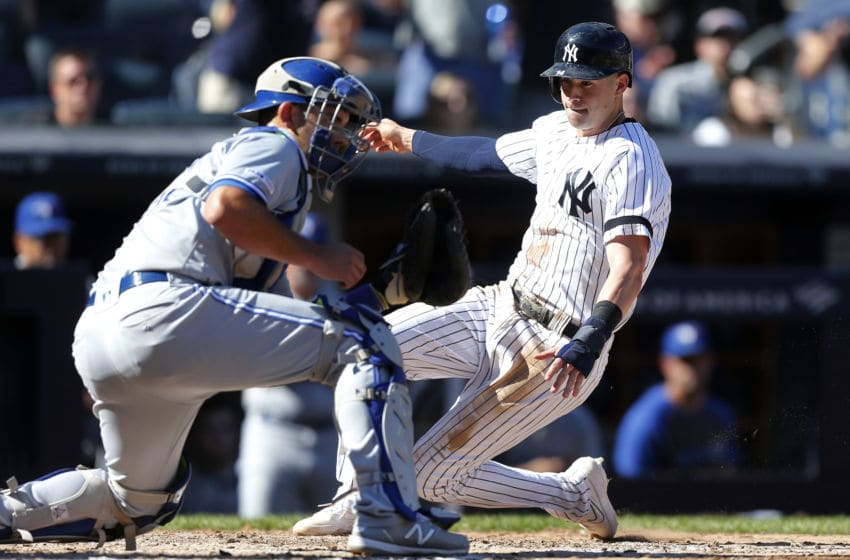 NEW YORK, NEW YORK - SEPTEMBER 21: Tyler Wade #14 of the New York Yankees slides home past Luke Maile #21 of the Toronto Blue Jays for a run in the sixth inning at Yankee Stadium on September 21, 2019 in the Bronx borough of New York City. (Photo by Jim McIsaac/Getty Images)